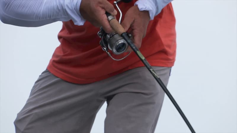 Man fishing with the St Croix spinning fishing reel