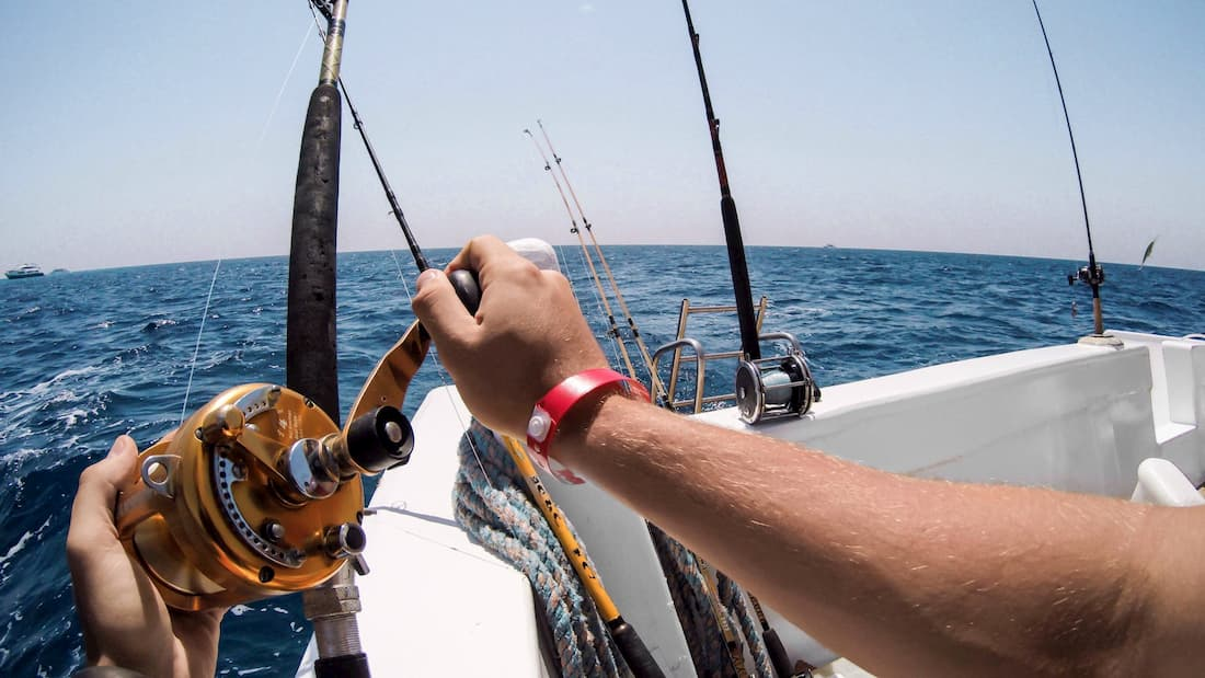 Man ocean fishing on a boat